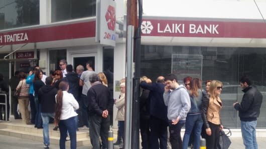 Cypriots line up at the ATM to withdraw their savings in the midst of the banking crisis in Nicosia, Cyprus.